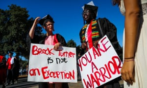 Stanford students carried signs in solidarity for a Stanford rape victim during graduation ceremonies in Palo Alto.