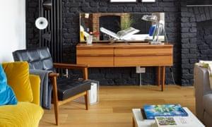 Paint it black: exposed brick walls, period furniture and wood flooring at Afroditi Krassa's house.