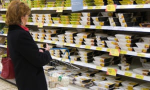 A shopper in the ready meal aisle of a supermarket