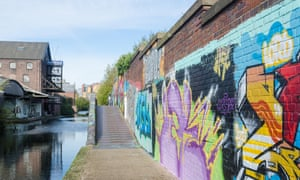 Colourful graffiti painted on brick walls beside the Digbeth Branch Canal towpath in Digbeth, Birmingham, UK