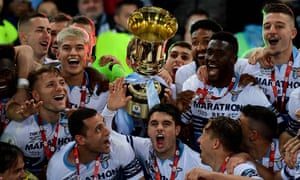 Lazio's players celebrate as they hold the trophy after beating Atalanta at the Stadio Olimpico.