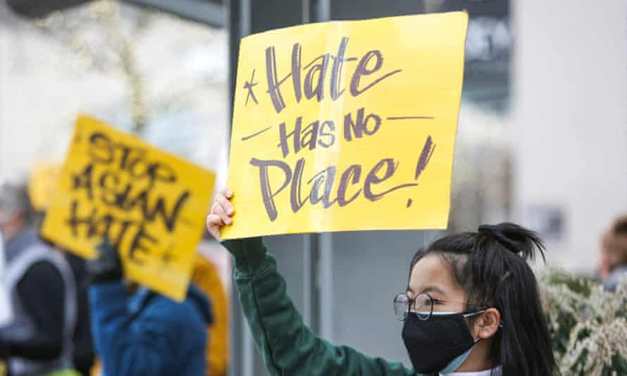 "A student who wished to remain anonymous, holds a sign that reads ""hate has no place"" during the We Are Not Silent rally organized by the Asian American Pacific Islander (AAPI) Coalition Against Hate and Bias in Bellevue, Washington on March 18, 2021."
