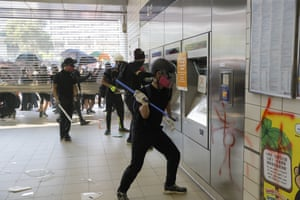 Anti-government protesters vandalise an MTR station.