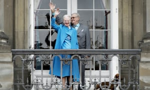 Queen Margrethe and Prince Henrik wave from the balcony at her 76th birthday celebrations last April.