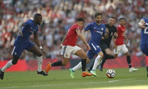 Manchester United's Alexis Sanchez glides past Rudiger and Fabregas.