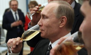 Vladimir Putin drinks champagne during an awards ceremony at the Kremlin