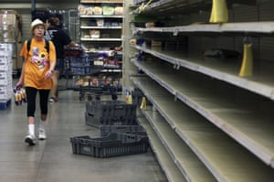 Kimberly Davis looks for last-minute supplies along virtually empty shelves on Saratoga Boulevard in Corpus Christi, Texas. Forecasters are predicting the fiercest hurricane for around a decade