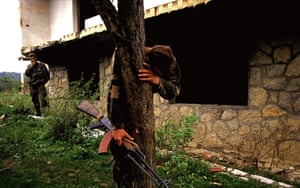 Senad Medanovic, sole survivor of a massacre finds his home in ruins after the Bosnian army recaptured his village from Serb forces. He is standing on what is believed to be a mass grave of sixty-‐nine people, including his family. 1995