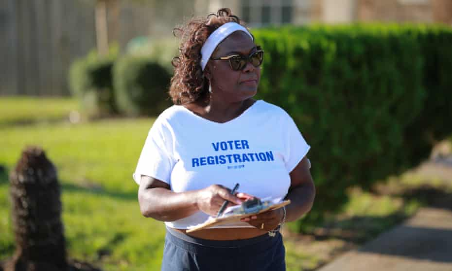 Cynthia Ginyard holds a clipboard full of voter registration cards on her canvassing trail. Ginyard has been the chair of the Fort Bend county Democratic party since 2016.