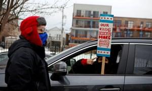 English Language Program teacher Marlon Henriquez and bilingual teacher at Pilsen Community Academy Daniela Lugo prepare for a car caravan of supporters of the Chicago Teachers Union, U.S., January 30, 2021.