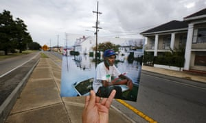 Errol Morning sitting on his boat on a flooded street