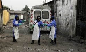 Members of a Médecins Sans Frontières team fumigate the Yolo Sud neighbourhood of Kinshasa.