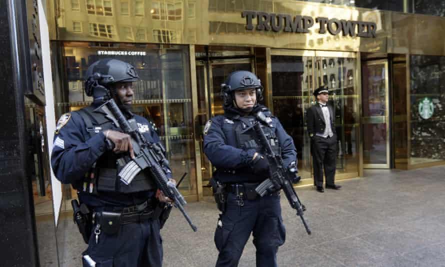 New York City Police officers guard the front of Trump Tower, in New York. The Pentagon plans to host the 'nuclear football' at the site, according to a letter.