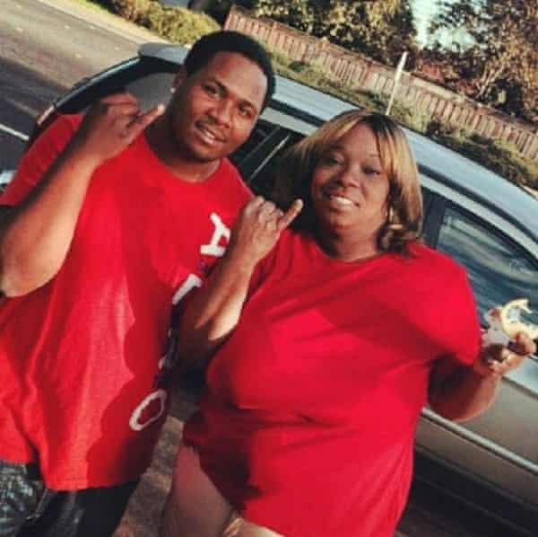 Dujuan Armstrong, left, with his mother, Barbara Doss.