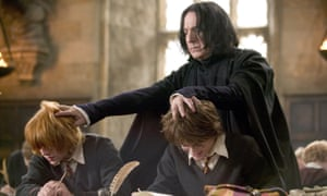 Rickman with Rupert Grint and Daniel Radcliffe in Harry Potter and the Goblet of Fire (2005).