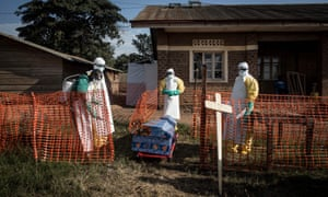 In this file photo taken on August 13, 2018 medical workers disinfect the coffin of a deceased unconfirmed Ebola patient inside an Ebola Treatment Centre in Beni. A woman died of the Ebola virus disease in eastern Democratic Republic of Congo on Sunday.