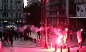 Protesters throw flares at riot police