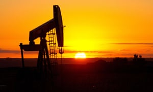 An oil well silhouetted in North Dakota