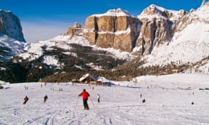 Skiers on the piste in Val di Fassa in the Dolomites.