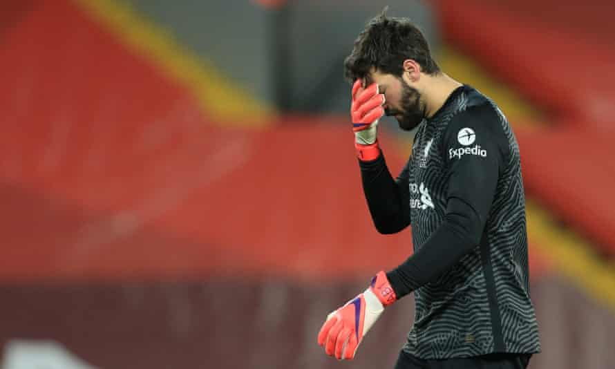Alisson can't believe it after he gifted Manchester City two chances which they took to go from 1-1 to 3-1 in front.