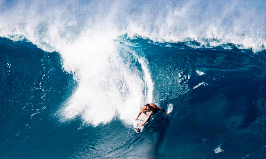 Australia's Mikey Wright surfs a wave at Pipeline on the north shore of Oahu, Hawaii, on 24 December, 2020.