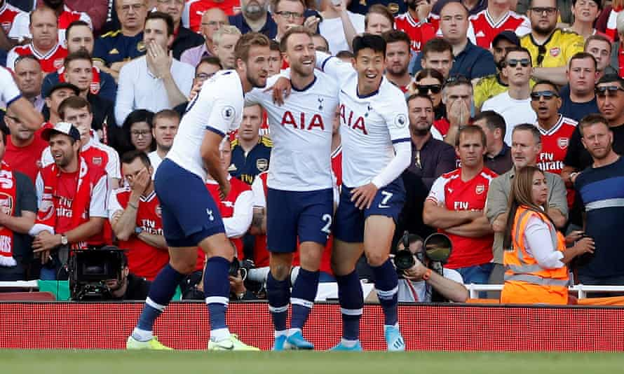 Christian Eriksen is congratulated by Harry Kane and Son Heung-min after scoring against Arsenal in September 2019
