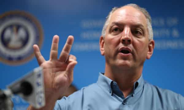 Louisiana governor John Bel Edwards discusses the flooding at a press conference.