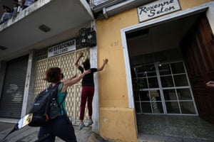 Guatemala City. Teenagers jump from a building as they escape the Zafiro shelter. Ten girls and teenagers who remained in a state shelter escaped after alleged rights abuses