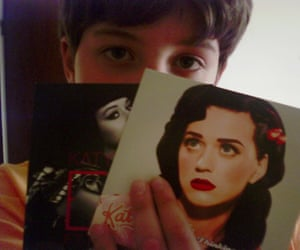 A 10-year-old Pedro João Santos holding his prized Katy Perry singles.