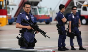 Armed Hong Kong police stand guard before the arrival of Zhang Dejiang.