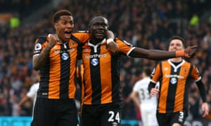 Oumar Niasse, right, celebrates scoring Hull's first goal against Swansea with Abel Hernández.