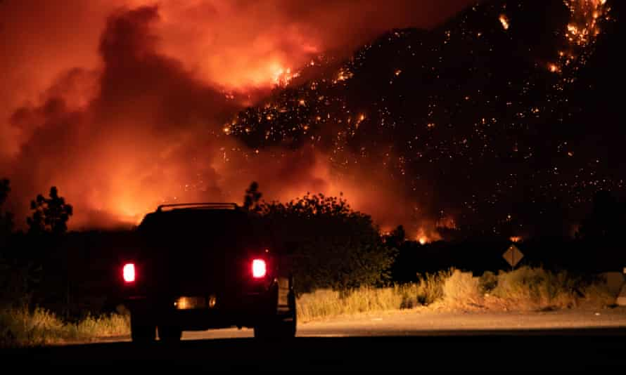 A wildfire burns on the side of a mountain in Lytton.