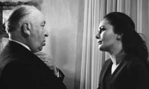 Karin Dor with Alfred Hitchcock during the filming of the 1969 film Topaz.