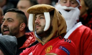 A Manchester United fan in a walrus outfit.