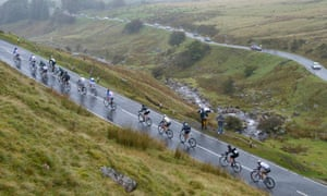 Tour of Britain riders ascend through driving rain in the Black Mountains of the Brecon Beacons.