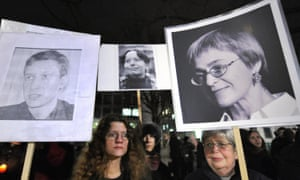 Activists demonstrate with photos of journalists, including Politkovskaya (right), who have been gunned down in Moscow since 2006.