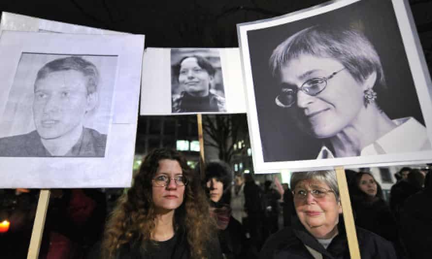 Reporters without Borders activists demonstrate in Berlin in 2009 with images of human rights lawyer Stanislav Markelov, and Novaya Gazeta journalists Anastasia Baburova and Anna Politkovskaya.