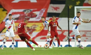 Fabinho thumps home Liverpool's third goal.