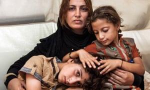 Ivor Prickett's photograph, Amira and her Children