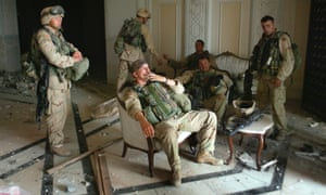 US troops relax after a search of one of Saddam Hussein's palaces in Baghdad, 2003.