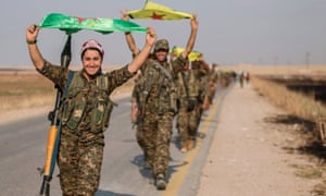 Kurdish fighters in northern Syria fly the flag.