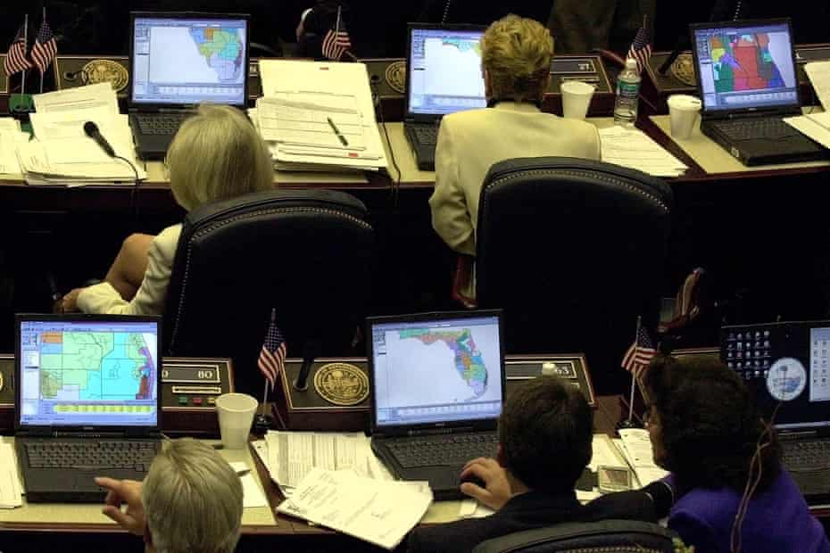 Florida state representatives look at redistricting plans on their computers during a hearing in March 2002.