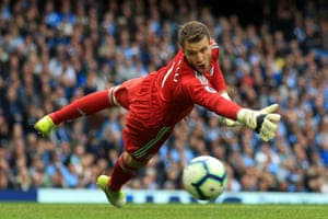 Fulham goalkeeper Marcus Bettinelli dives for the ball. City won the game 3-0, thanks to goals from Leroy Sane, David Silver and Raheem Sterling.