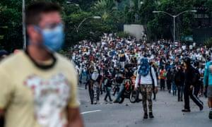 Venezuelan opposition activists demonstrate against the president in Caracas.