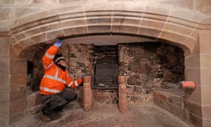 Works on a fireplace as part of the £3m restoration of Lindisfarne Castle on Holy Island.