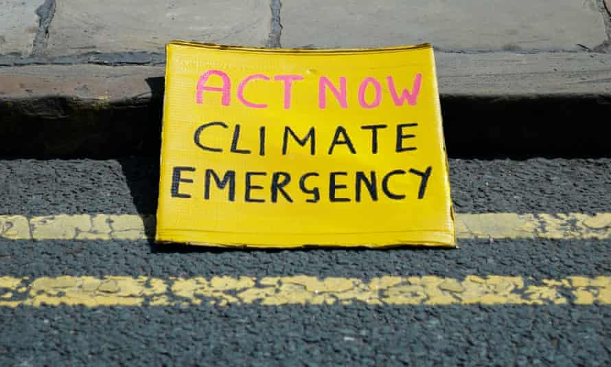 Sign reading Act Now Climate Emergency