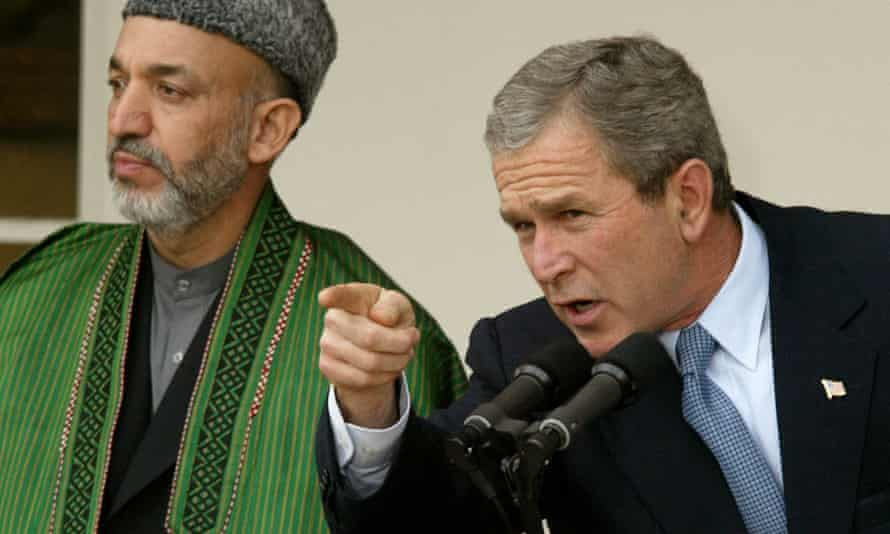 George W Bush with Hamid Karzai, then Afghanistan's interim authority chairman, in January 2002