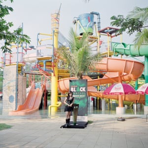 Jakarta, Indonesia. A salesperson promoting Djarum Black Menthol cigarettes during a music parade inside a waterpark