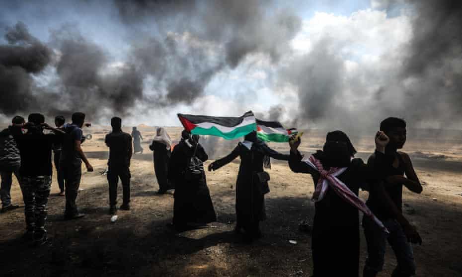 Palestinians set tyres on fire near Gaza-Israel border in Khan Yunis, Gaza.