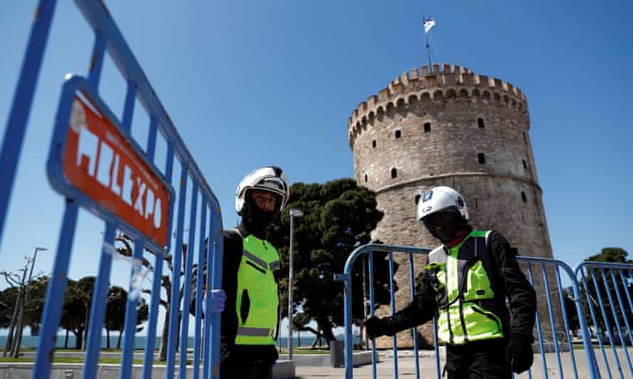 Police close off a seaside promenade in Thessaloniki, Greece